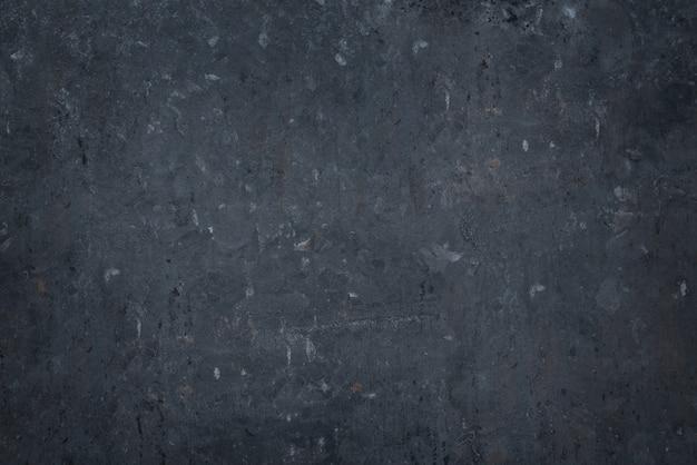 Texture de pierre en béton gris foncé.