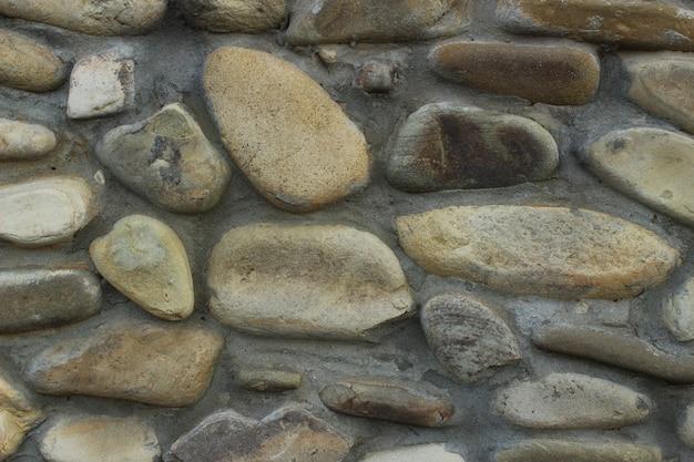 Une texture de pierre grossière se bouchent