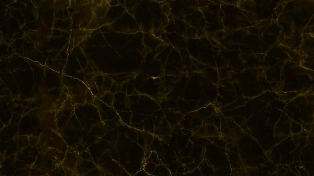 Texture de pierre de marbre noir et doré pour le fond ou le sol de carreaux de luxe