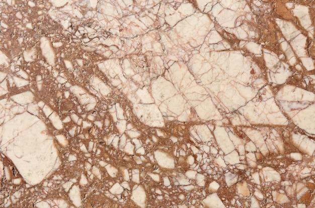 Texture de pierre marron marbré. fond de mur clair.