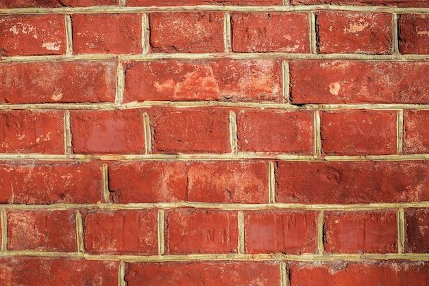Texture de pierre de mur de briques rouges