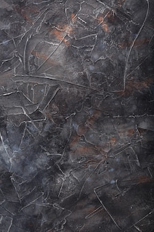 Texture pierre le mur est gris foncé avec des taches dans le style loft. plein écran en tant que
