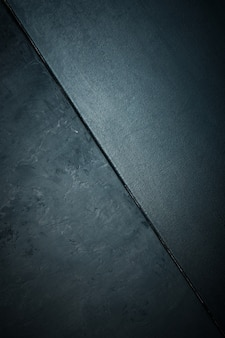 Texture de pierre ou de roche rugueuse et texture toile de couleur noire. élégant avec grunge vieilli vieilli et fond gris foncé.