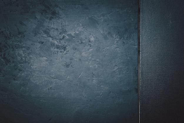 Texture de pierre ou de roche rugueuse et texture toile de couleur noire. élégant avec vintage grunge en détresse et fond gris foncé.