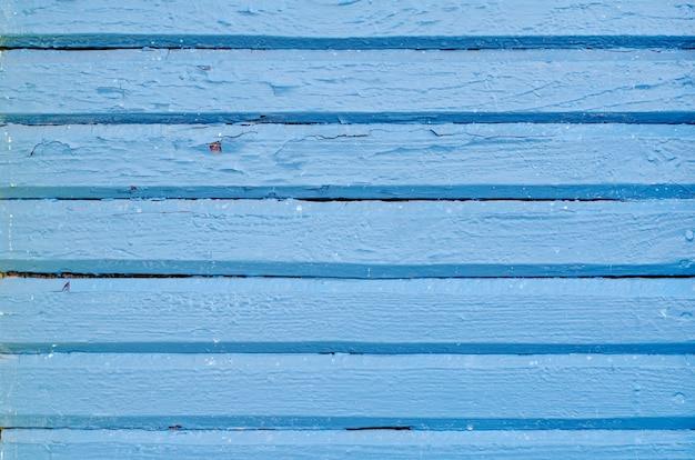 Texture de planche de bois peint bleu patiné fissuré