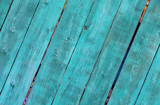 Texture de planche de bois peint vert et bleu peint craquelé, vue de face