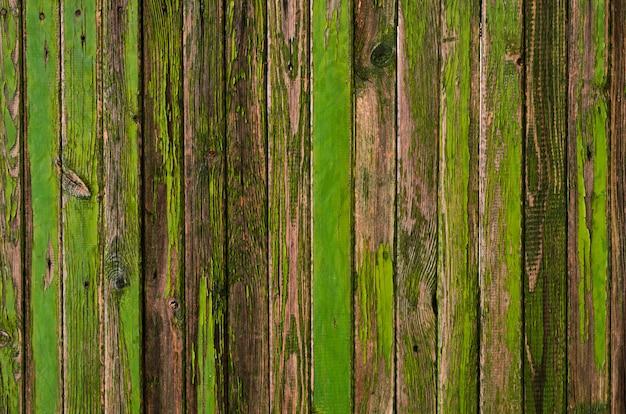 Texture de planche de bois peint vert et bleu peint craquelé
