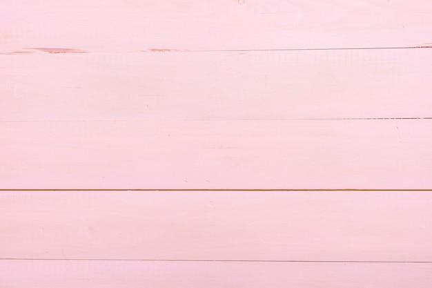 Texture de planche de bois rose pour le fond