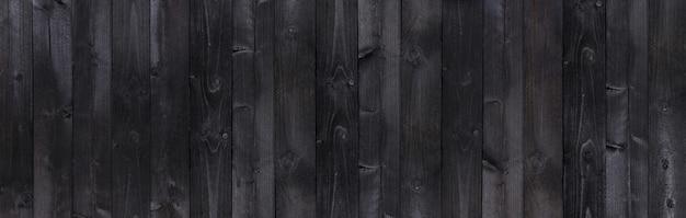 Texture de planches de bois anciennes et larges en bois noir