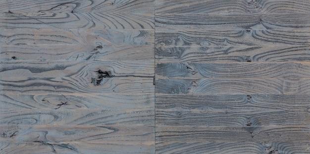 Texture de planches de mur en bois de grange vieilles lattes de bois massif sur fond minable rustique
