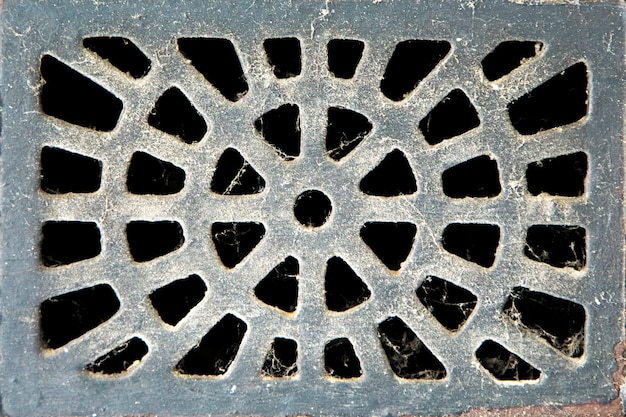 Texture de la plaque d'égout en métal de la canalisation d'égout de la rue