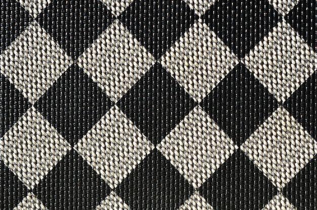 Texture plastique sous la forme d'une très petite reliure en toile, peinte en noir et gris
