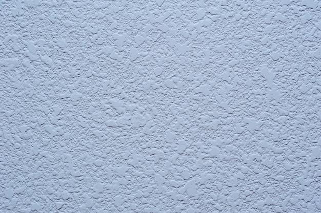 Texture de plâtre sur fond bleu