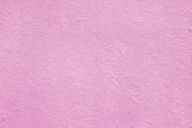 Texture de plâtre rose rugueux. abstrait architectural.