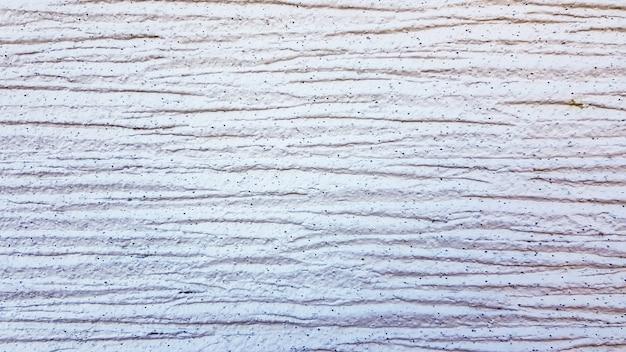 Texture de plâtre texturé blanc. revêtement mural décoratif à rayures horizontales. arrière-plan pour le texte. fond abstrait moderne clair.
