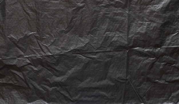 Texture de polyéthylène foncé avec des ecchymoses et un fond de poussière