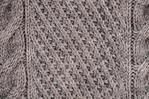 La texture d'un pull douillet tricoté. tricot, accessoires pour la maison.