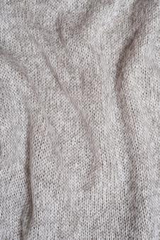 Texture d'un pull en laine gris