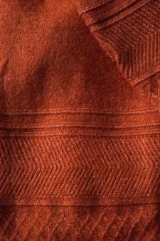Texture d'un pull en tricot d'automne avec un motif. fond confortable d'automne.
