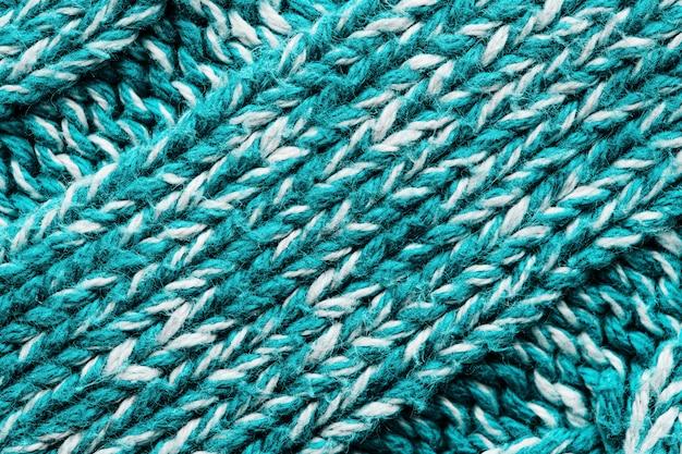 Texture d'un pull en tricot bleu.