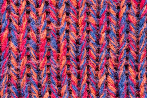 Texture de pull en tricot rose mélangé. espace copie