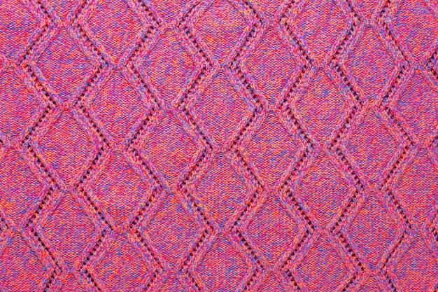 Texture de pull en tricot rose mélangé