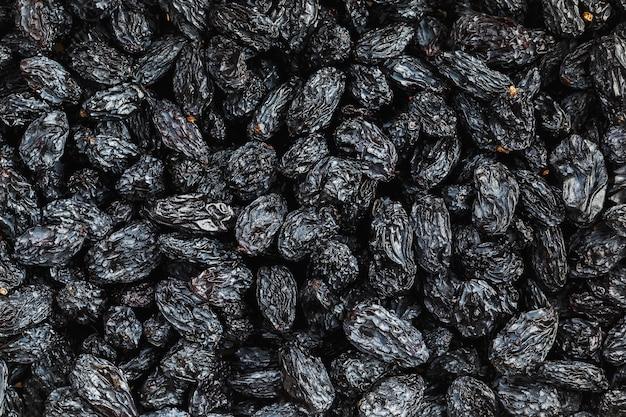 Texture de raisin noir, fruits secs populaires. raisins secs.