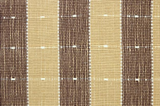 Texture rayée en tissu brun pour l'arrière plan