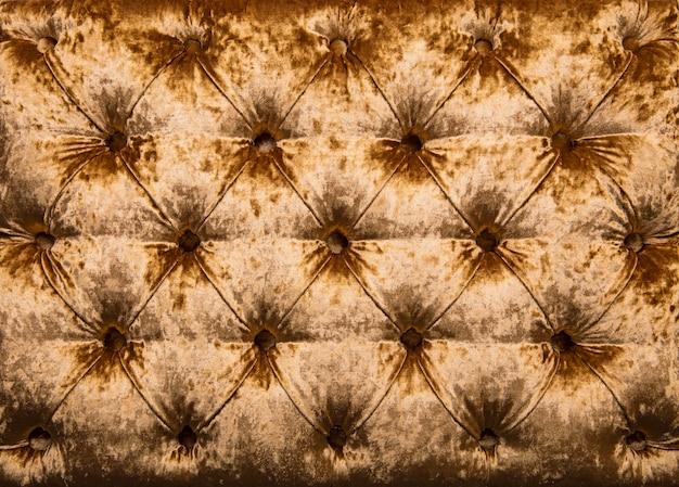 Texture de rembourrage en velours capitonné doré