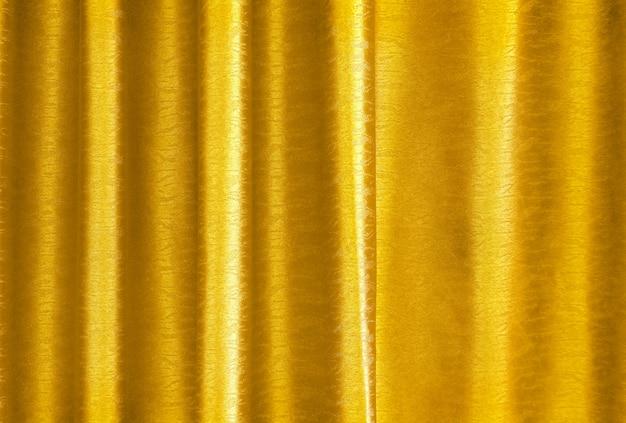 Texture de rideau en soie jaune doré de luxe