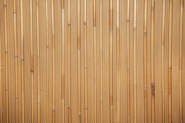 Texture de roseaux secs. papier peint nature organique de canne jaune. fond en bois chaud naturel avec bambou et paille