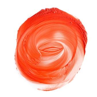 Texture de rouge à lèvres orange tachée. photographie de produits cosmétiques.