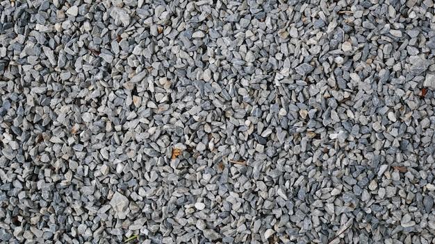 Texture de route asphaltée, fond de pierre