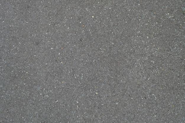 Texture de route asphaltée lisse de motif de conception noire, fond de vue de dessus.