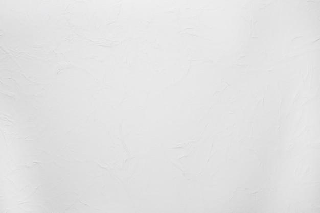 Texture rugueuse du mur de ciment plâtré blanc