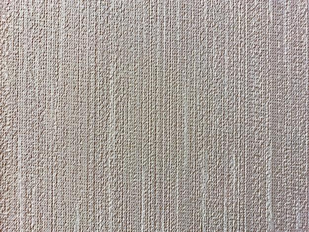 La texture rugueuse du tissu sur fond de papier gris est utilisée pour la conception de papier peint