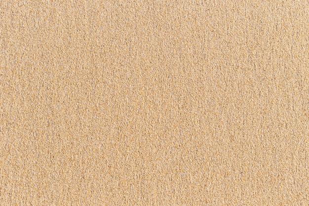 Texture de sable brillant abstrait sur la plage pour le fond