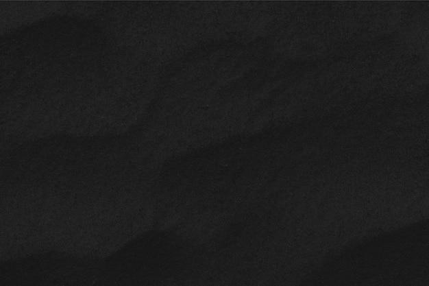 Texture de sable noir. fond d'écran et concept de black friday.