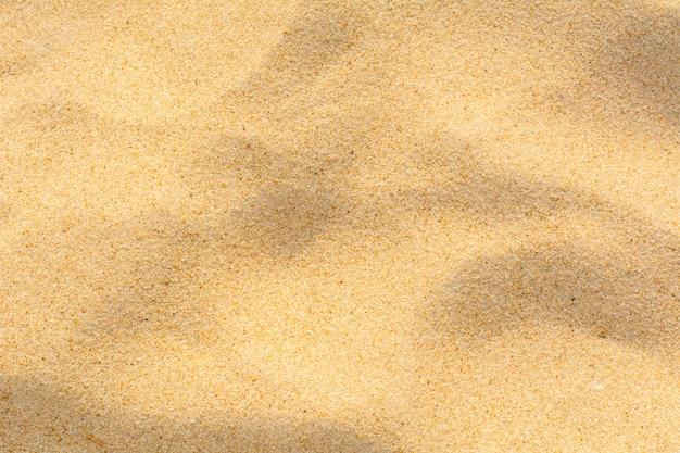Texture de sable sur la plage en arrière-plan.