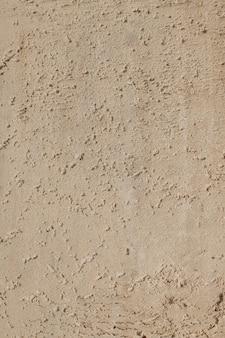 Texture de sable sur la plage de bord de mer - look rétro et vintage.