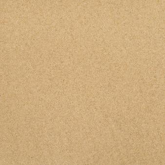 Texture sable. plage de sable pour le fond. vue de dessus