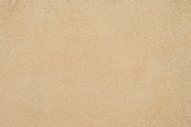 Texture de sable. le sable brun. fond de sable fin. contexte de sable.