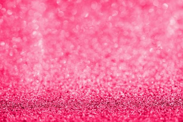 Texture scintillante abstraite de paillettes roses