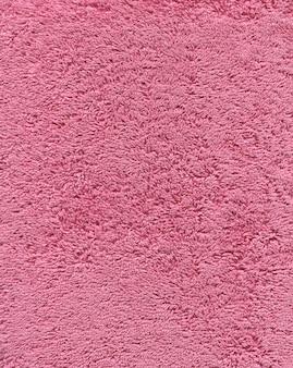 Texture de serviette de bain de couleur rose. fond de serviette de bain en tissu rose.