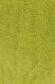 Texture de serviette verte ou fond de tissu vert