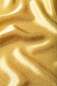 Texture de soie de tissu doré