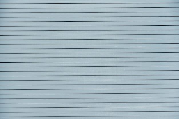 Texture soignée du bâtiment bleu