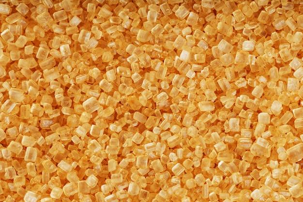 Texture de sucre de canne doré avec surface solide en plein écran