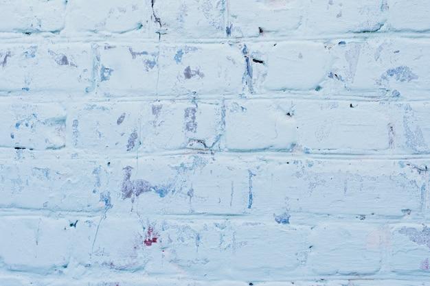 Texture de la surface du mur de brique bleu ancien avec des joints de ciment