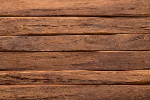 Texture de table en bois foncé, fond de planches marron